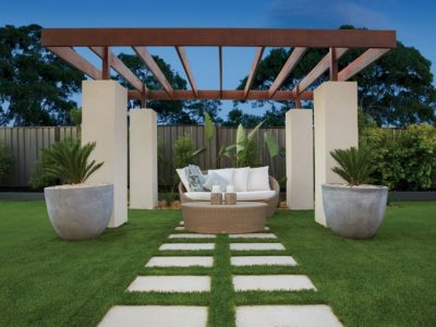 Outdoor Living Stepping Stones with Synthetic Grass under Alfresco Feature